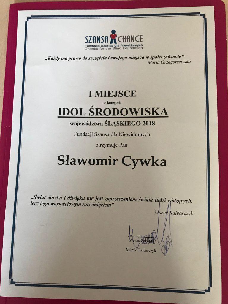 Dyplom dla Sławomira Cywki